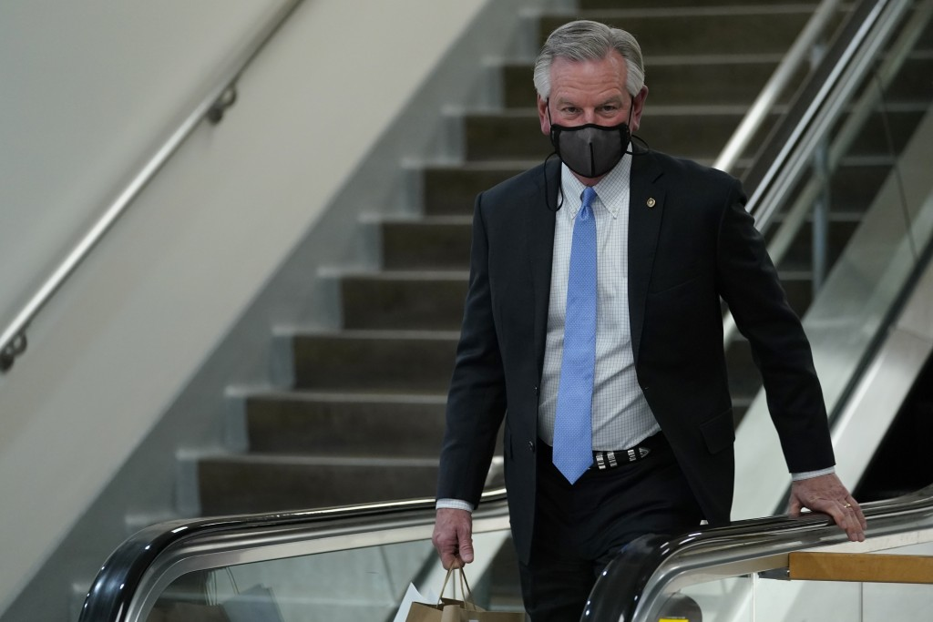 Sen. Tommy Tuberville, R-Ala., walks on Capitol Hill in Washington, Wednesday, Feb. 10, 2021, during a break on the second day of the second impeachme...