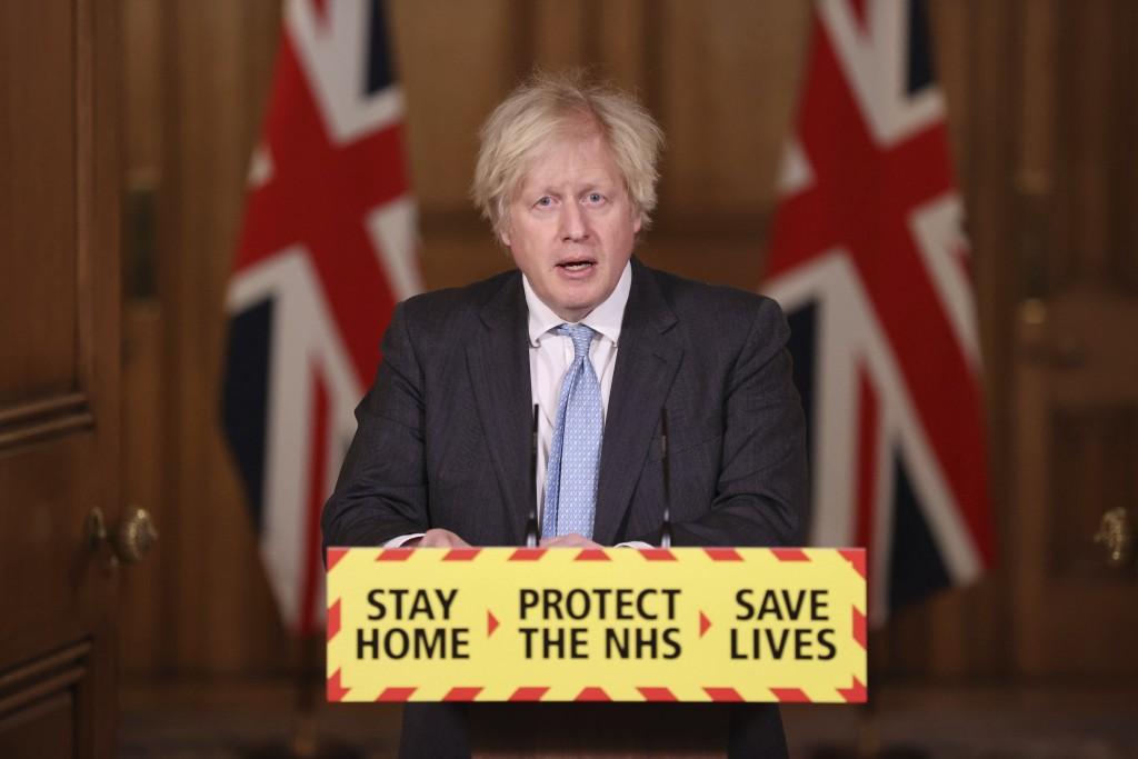 Britain's Prime Minister Boris Johnson during a media briefing on coronavirus (COVID-19) in Downing Street, London, Wednesday February 10, 2021. (Stev...