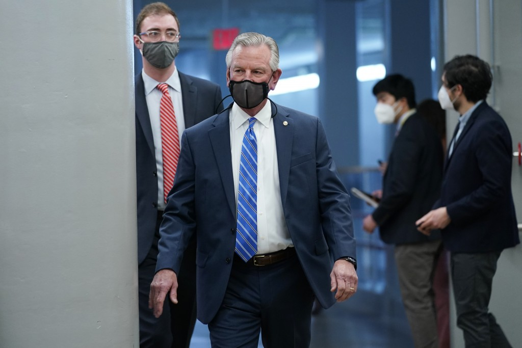 Sen. Tommy Tuberville, R-Ala., walks on Capitol Hill in Washington, Thursday, Feb. 11, 2021, before the start of the third day of the second impeachme...