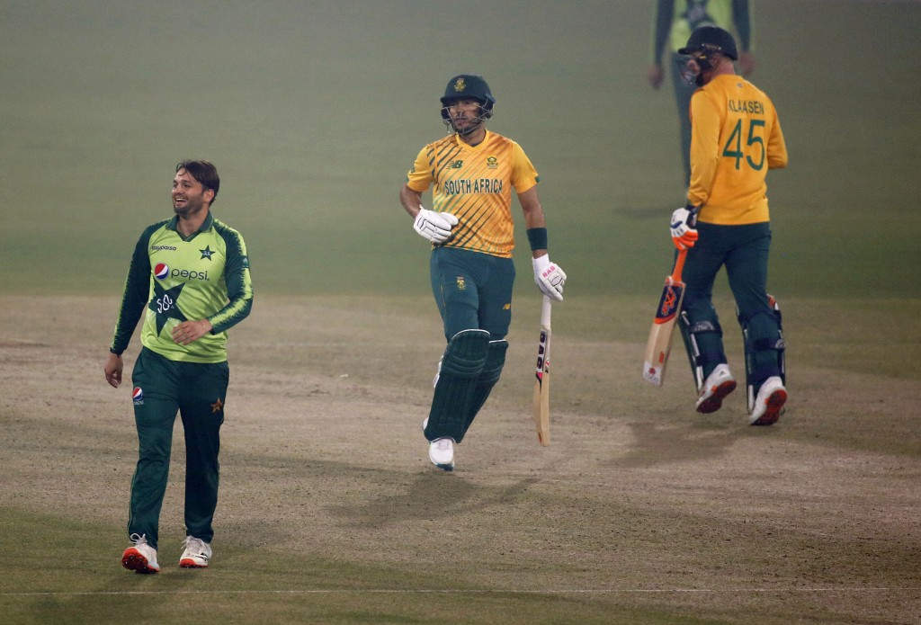 South Africa's Reeza Hendricks, center, and Heinrich Klaasen, right, runs between the wicket while Pakistan's Usman Qadir watches during the 1st Twent...