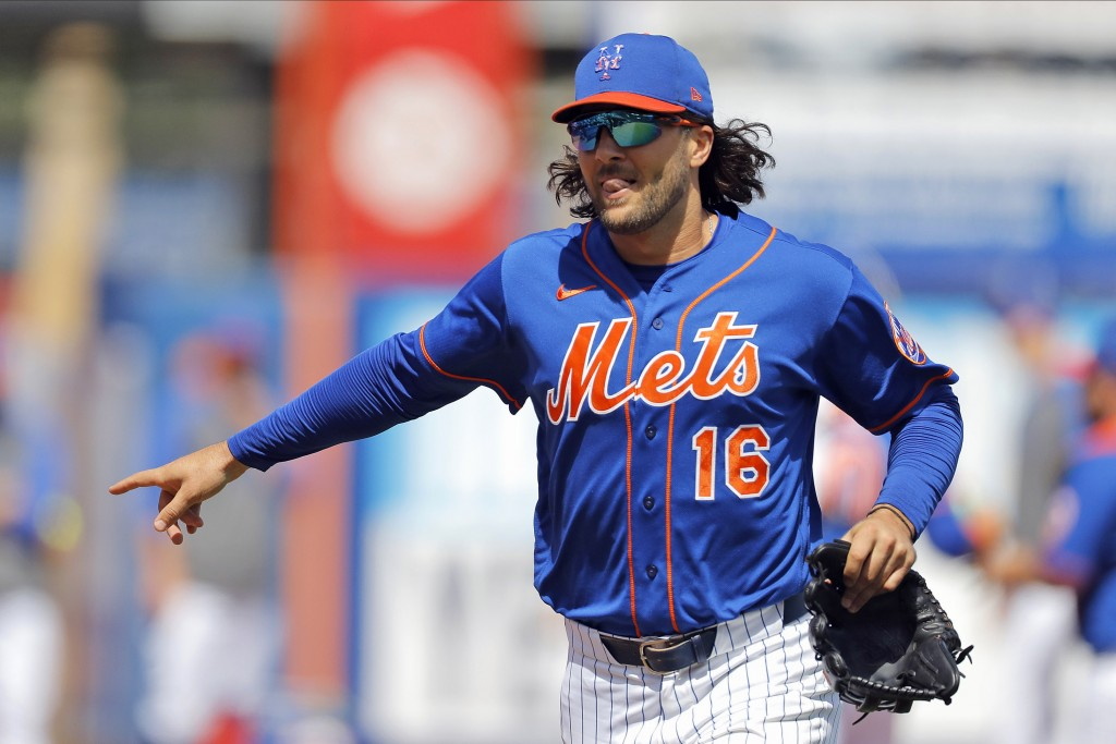 FILE - In this March 11, 2020, file photo, New York Mets center fielder Jake Marisnick gestures while running to the dugout prior to a spring training...