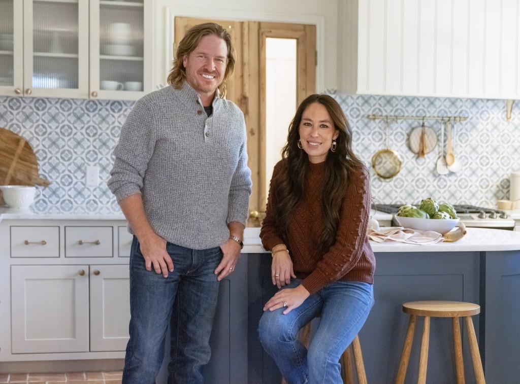 """This image released by Magnolia Network shows Chip and Joanna Gaines from the sixth season of """"Fixer Upper."""" Magnolia Network, a joint venture between..."""