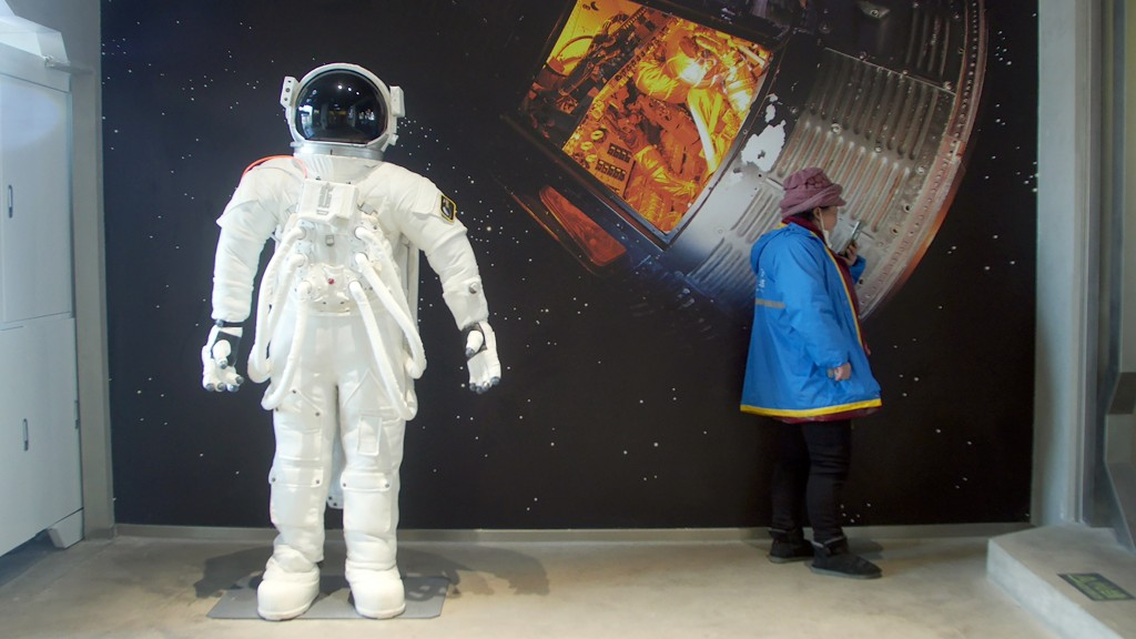 A delivery driver waits for an order at a space-themed cafe in Beijing, Wednesday, Feb. 10, 2021. China is falling in love with space, inspired by the...