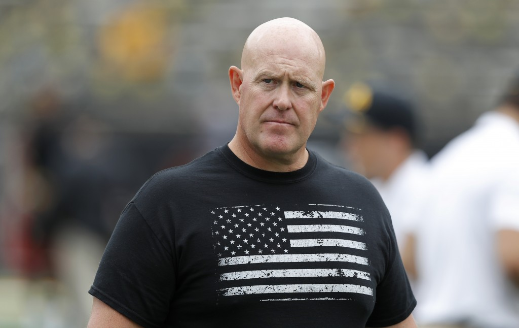 FILE - In this Sept. 1, 2018, file photo, Iowa strength and conditioning coach Chris Doyle walks on the field before an NCAA college football game bet...