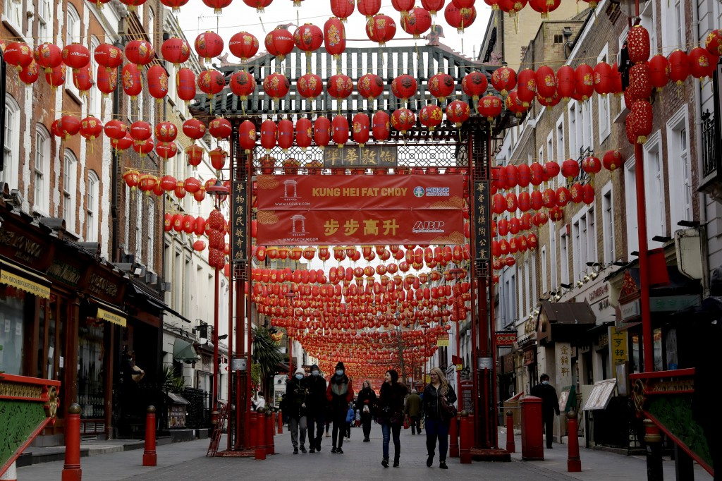 People walk beneath lanterns hung across the street to celebrate the Chinese Lunar New Year which marks the Year of the Ox, in the Chinatown district ...