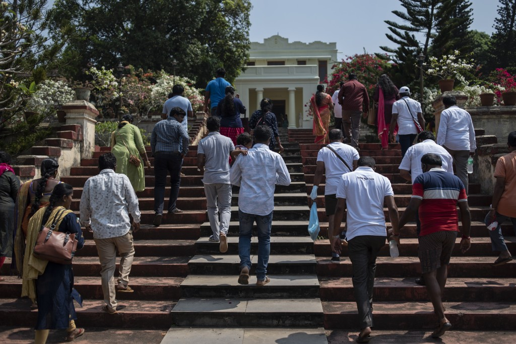 A group of tourists from Bangalore visit the Hill Palace archaeological museum that reopened eleven months after it was closed due to the coronavirus ...