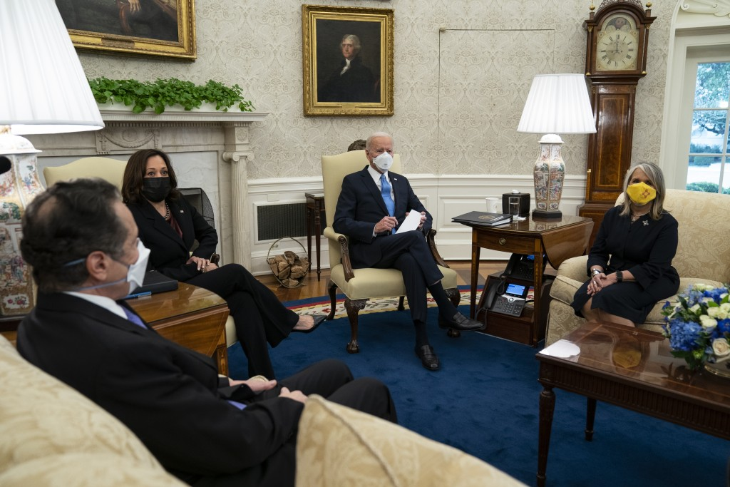 President Joe Biden speaks during a meeting with a bipartisan group of mayors and governors to discuss a coronavirus relief package, in the Oval Offic...