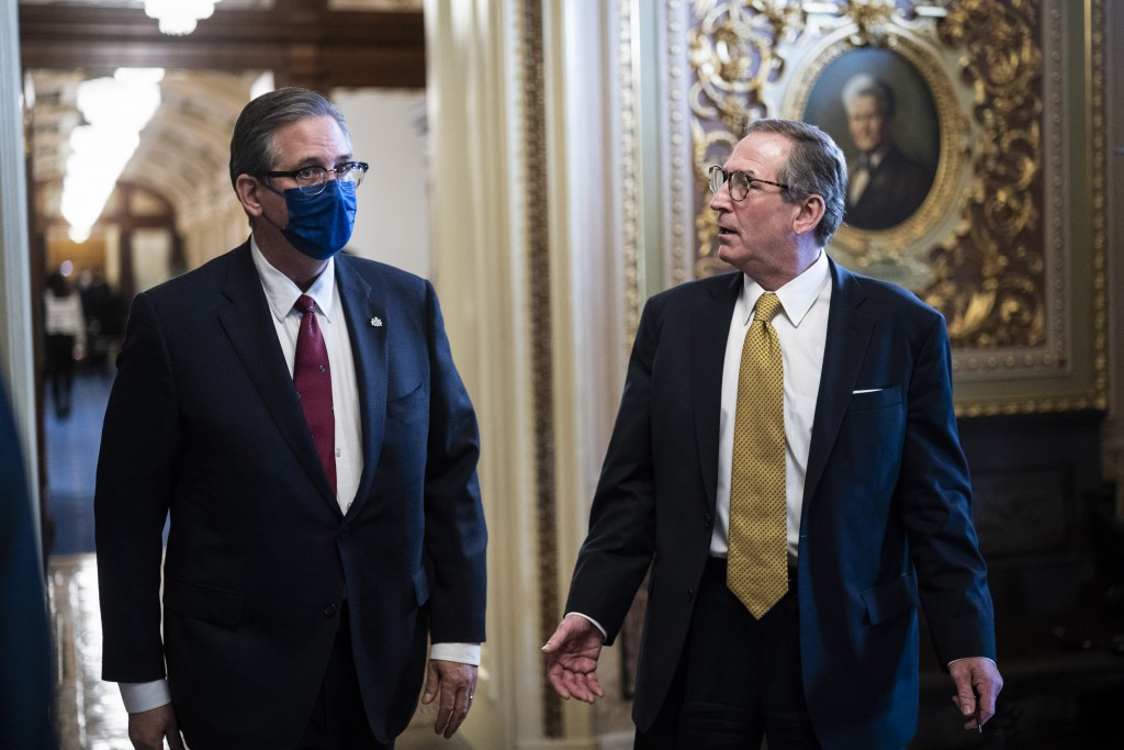 Bruce Castor and Michael van der Veen, lawyers for former President Donald Trump, walk back to their meeting room during a break through the Senate Re...