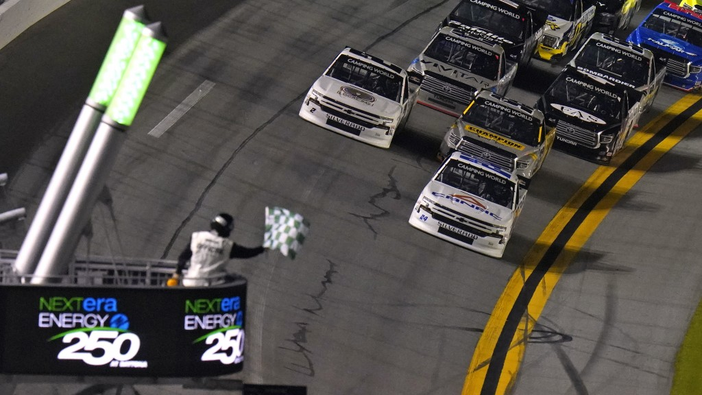 Raphael Lessard (24) beats the field to the line to win the first stage during a NASCAR Camping World Truck Series auto race Friday, Feb. 12, 2021, at...