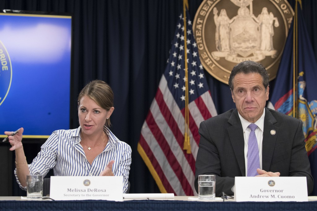 FILE — In this Sept. 14, 2018 file photo, Secretary to the Governor Melissa DeRosa, is joined by New York Gov. Andrew Cuomo as she speaks to reporters...