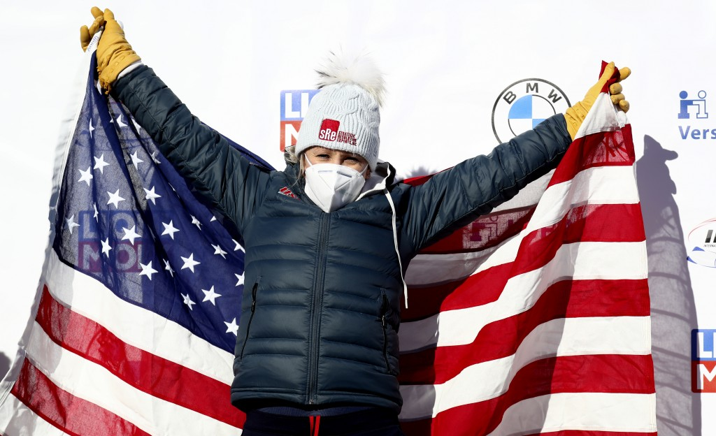 Bobsleigh pilot Kaillie Humphries of the United States celebrates on the podium after taking first place in the women's monobob race at the Bobsleigh ...