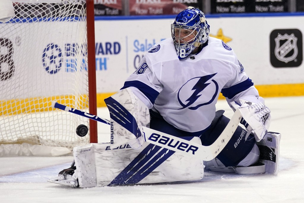 Tampa Bay Lightning goaltender Andrei Vasilevskiy stops the puck during the second period of an NHL hockey game against the Florida Panthers, Saturday...