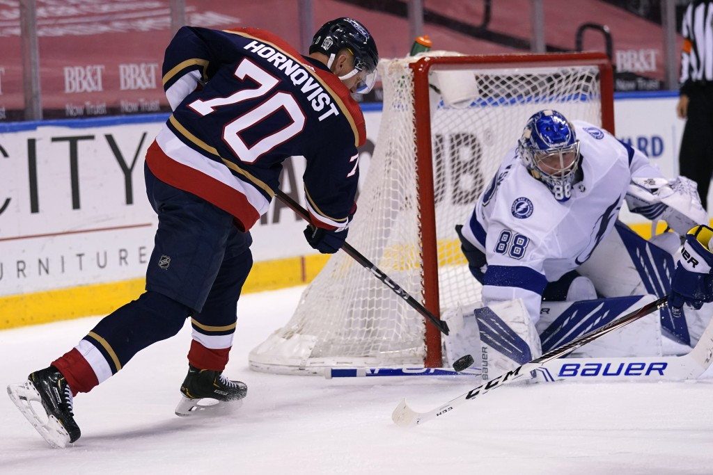 Florida Panthers right wing Patric Hornqvist (70) attempts a shot on the goal as Tampa Bay Lightning goaltender Andrei Vasilevskiy (88) defends during...