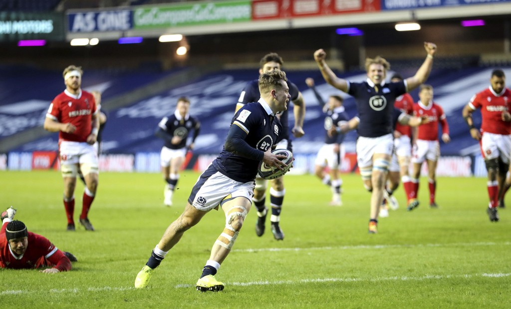 Scotland's Darcy Graham runs in to score his side's first try, during the Six Nations rugby union international match  between Scotland and Wales,  at...