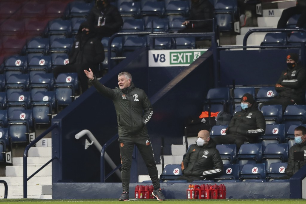 Manchester United's manager Ole Gunnar Solskjaer gives instructions from the side line during the English Premier League soccer match between West Bro...