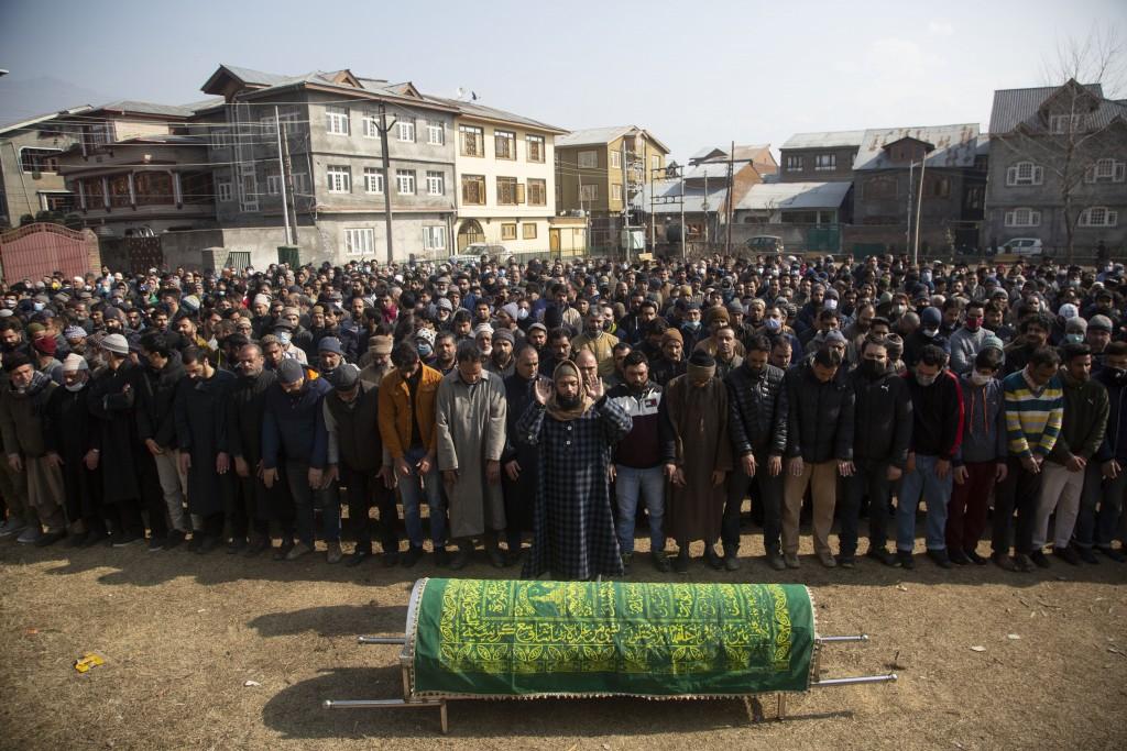 Kashmiri Muslims offer funeral prayers near the coffin of Basharat Ahmad Zargar in Srinagar, Indian-controlled Kashmir, Sunday, Feb.14, 2021. Zargar, ...