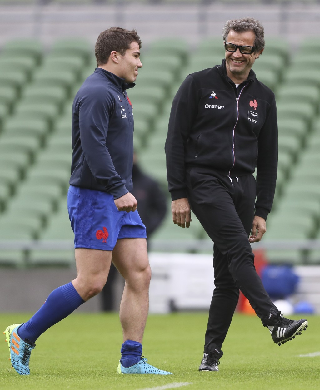 Antoine Dupont of France speaks with French team coach Fabien Galthie during the warm-up before the Six Nations rugby union match between Ireland and ...