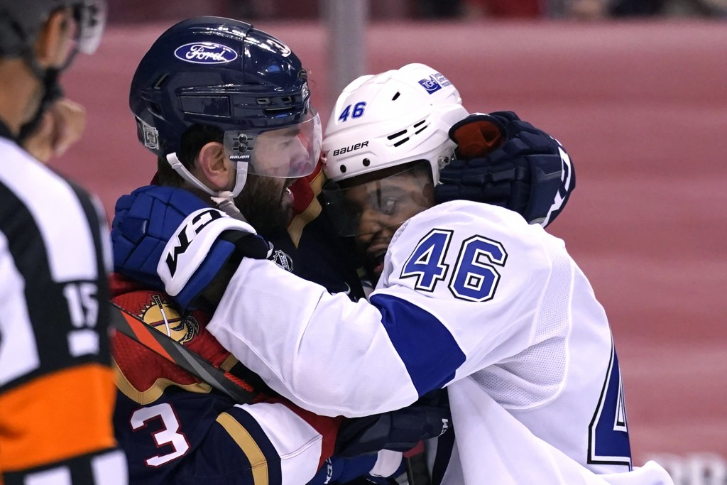 Florida Panthers defenseman Keith Yandle (3) and Tampa Bay Lightning center Gemel Smith (46) fight during the third period of an NHL hockey game, Satu...