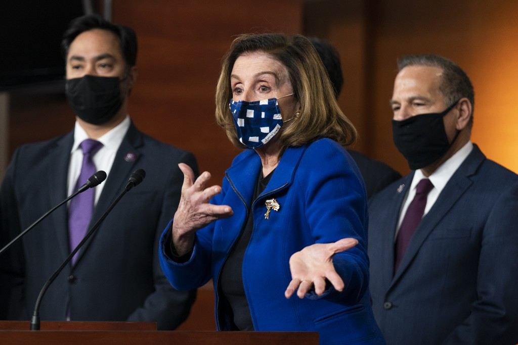 House Speaker Nancy Pelosi of Calif., with impeachment managers Rep. David Cicilline, D-R.I., and Rep. Joaquin Castro, D-Texas, speaks to members of t...
