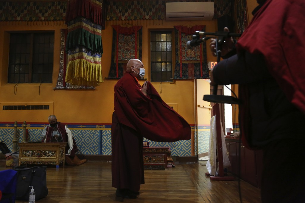 Lama Ngawang Yonten and other Buddhist members of the United Sherpa Association prepare for the Dakini Day practice, a group meditationthat includes...