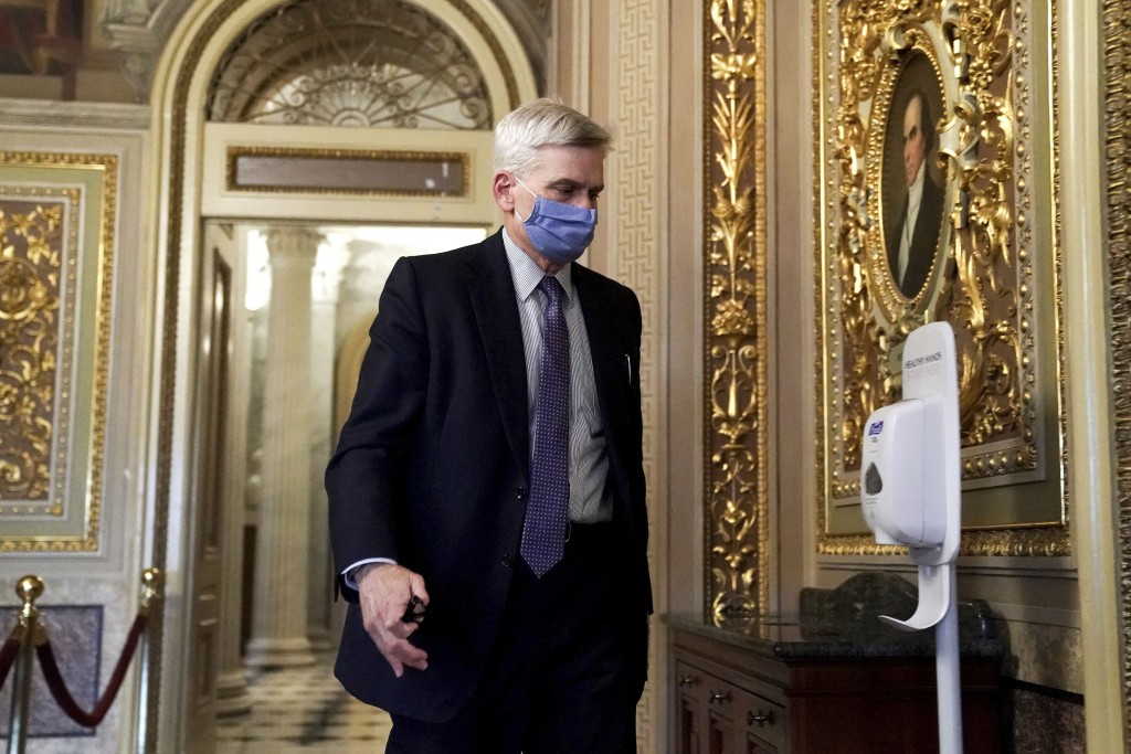 Sen. Bill Cassidy, R-La., walks on Capitol Hill after the Senate acquitted former President Donald Trump in his second impeachment trial in the Senate...
