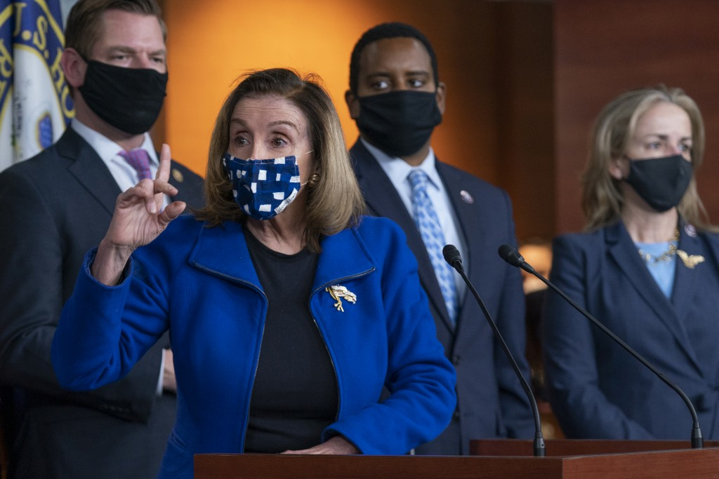 House Speaker Nancy Pelosi of Calif., with impeachment managers Rep. Eric Swalwell, D-Calif., Rep. Madeleine Dean, D-Pa., and Rep. Joe Neguse, D-Colo....