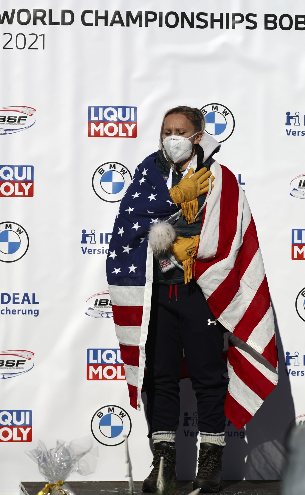 Bobsleigh pilot Kaillie Humphries of the United States stands on the podium after taking first place in the women's monobob race at the Bobsleigh and ...