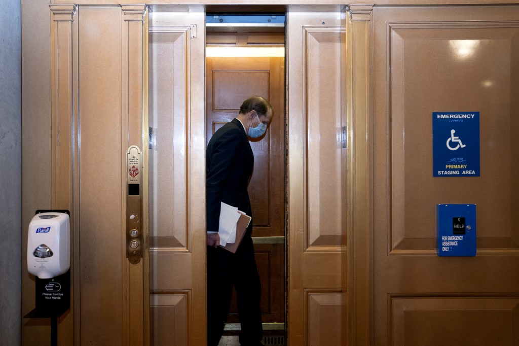 Sen. Ron Wyden, D-Ore., gets into a elevator on Capitol Hill after the Senate acquitted former President Donald Trump in his second impeachment trial ...
