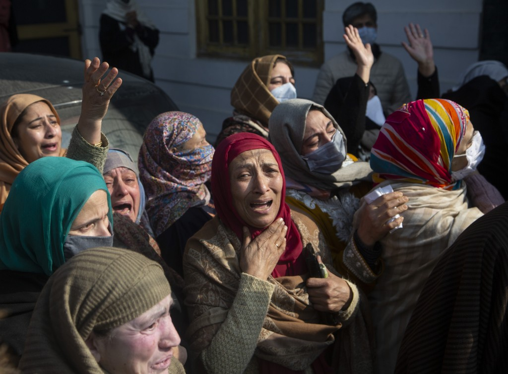 Relatives and family members cry near the coffin of Basharat Ahmad Zargar in Srinagar, Indian-controlled Kashmir, Sunday, Feb.14, 2021. Zargar, who wa...