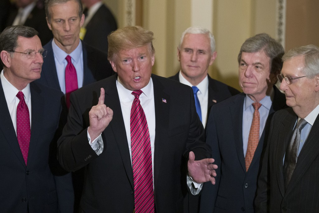 FILE - In this Wednesday, Jan. 9, 2019 file photo, Sen. John Barrasso, R-Wyo., left, and Sen. John Thune, R-S.D., stand with President Donald Trump, V...