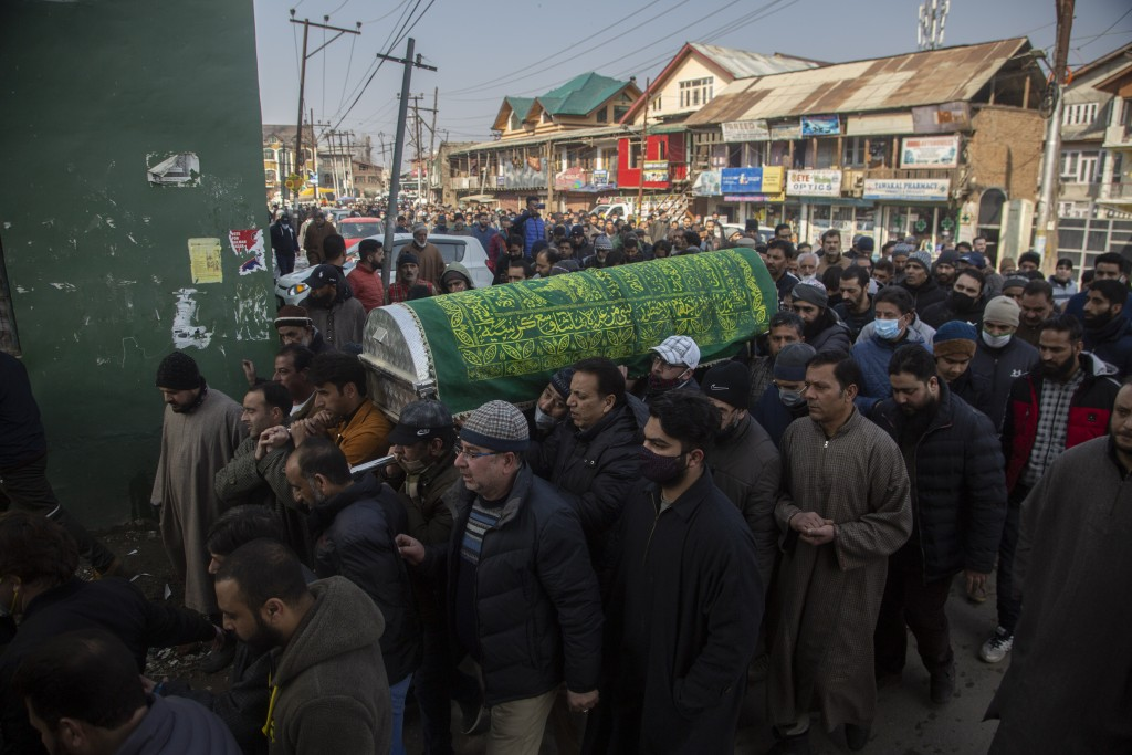 Kashmiri Muslims carry the coffin of Basharat Ahmad Zargar in Srinagar, Indian-controlled Kashmir, Sunday, Feb.14, 2021. Zargar, who was working at a ...
