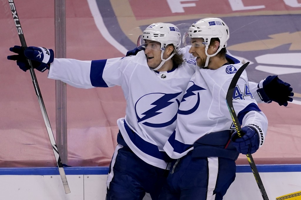 Tampa Bay Lightning right wing Alexander Volkov, left, celebrates with defenseman Jan Rutta (44) after scoring a goal against the Florida Panthers dur...