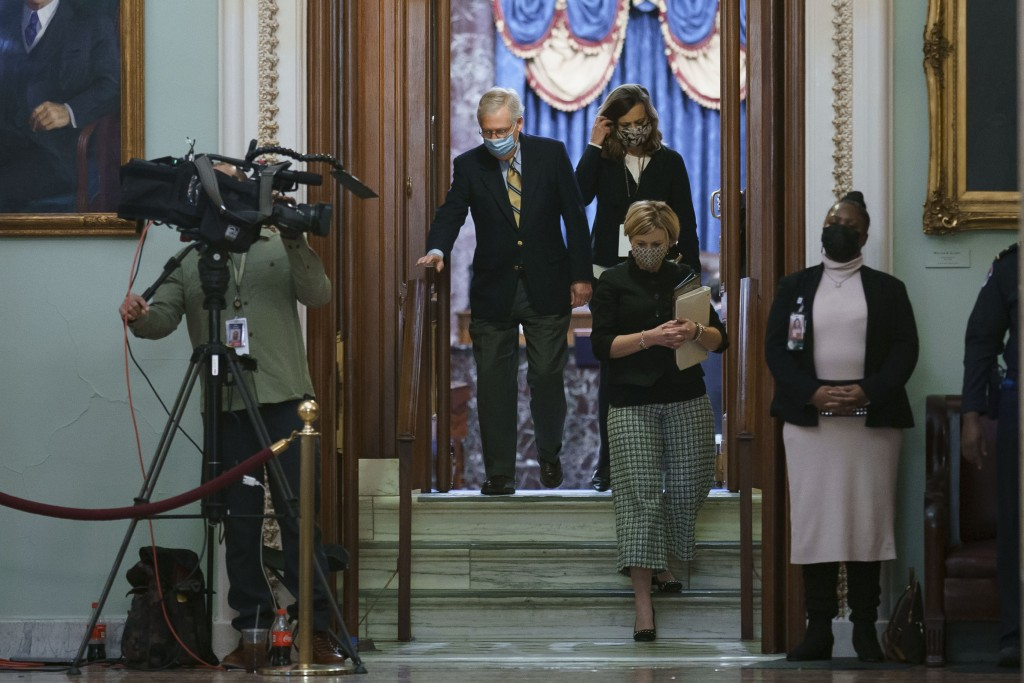 Senate Minority Leader Mitch McConnell, R-Ky., leaves the chamber after the Senate voted not guilty in the impeachment trial of former President Donal...