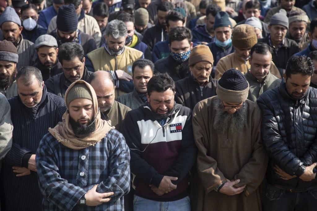 An unidentified relative of Basharat Ahmad Zargar weeps during his funeral in Srinagar, Indian-controlled Kashmir, Sunday, Feb.14, 2021. Zargar, who w...