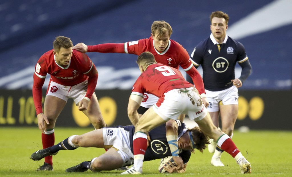Scotland's Hamish Watson is brought down, during the Six Nations rugby union international match  between Scotland and Wales,  at BT Murrayfield Stadi...