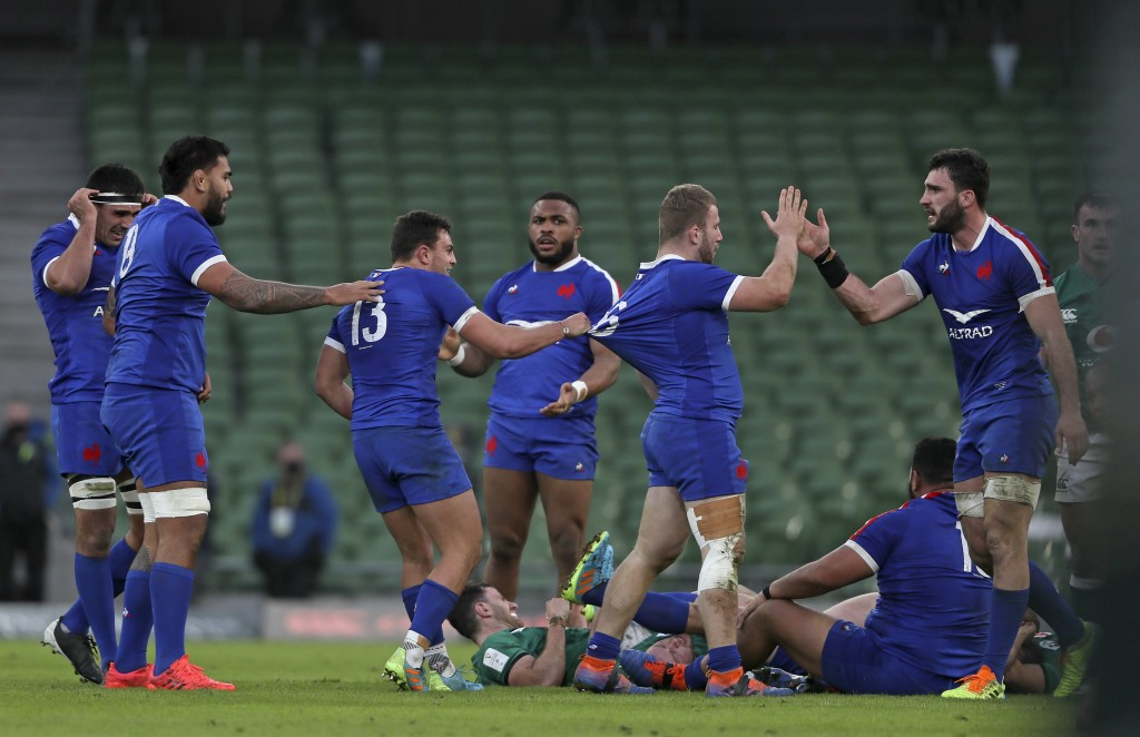 French players celebrate at the end of the Six Nations rugby union match between Ireland and France Aviva Stadium, Dublin, Sunday, Feb. 14, 2021. Fran...