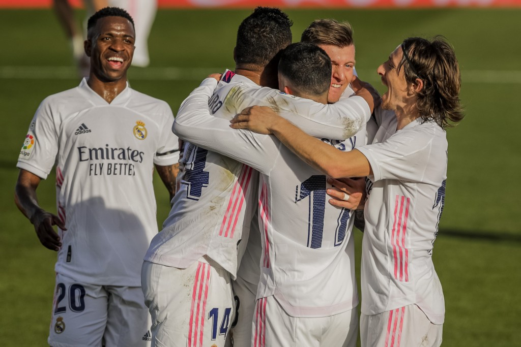 Real Madrid celebrate after scoring their second goal during the Spanish La Liga soccer match between Real Madrid and Valencia at the Alfredo Di Stefa...
