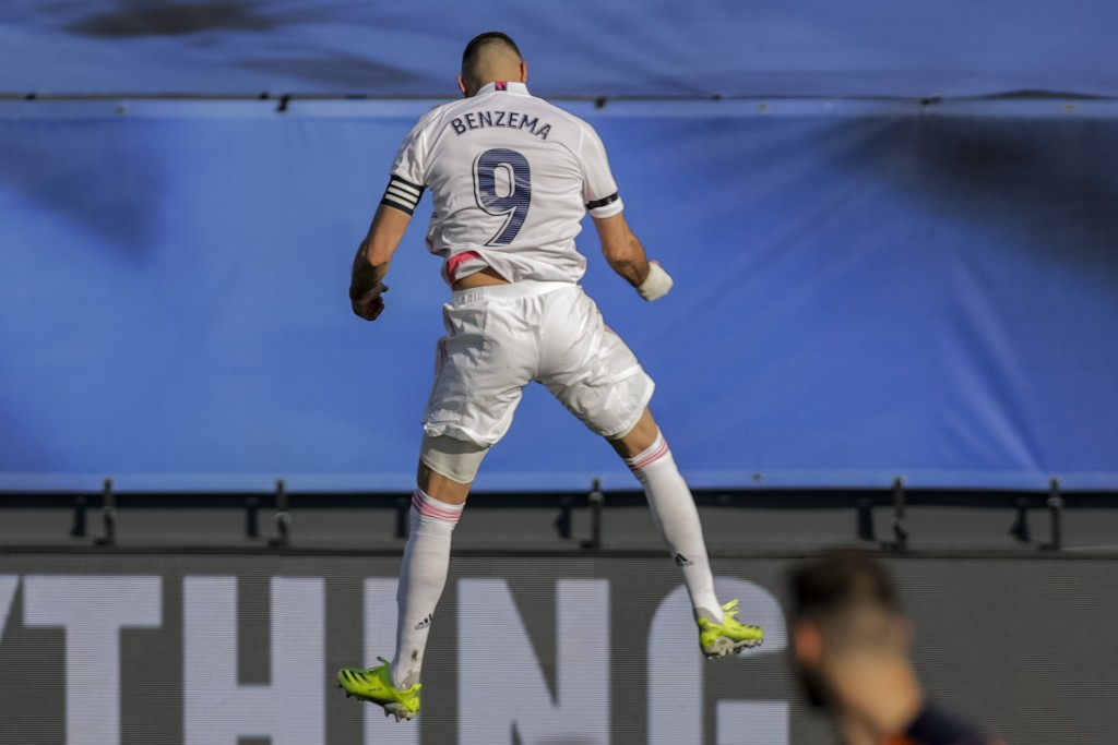 Real Madrid's Karim Benzema celebrates after scoring the opening goal during the Spanish La Liga soccer match between Real Madrid and Valencia at the ...