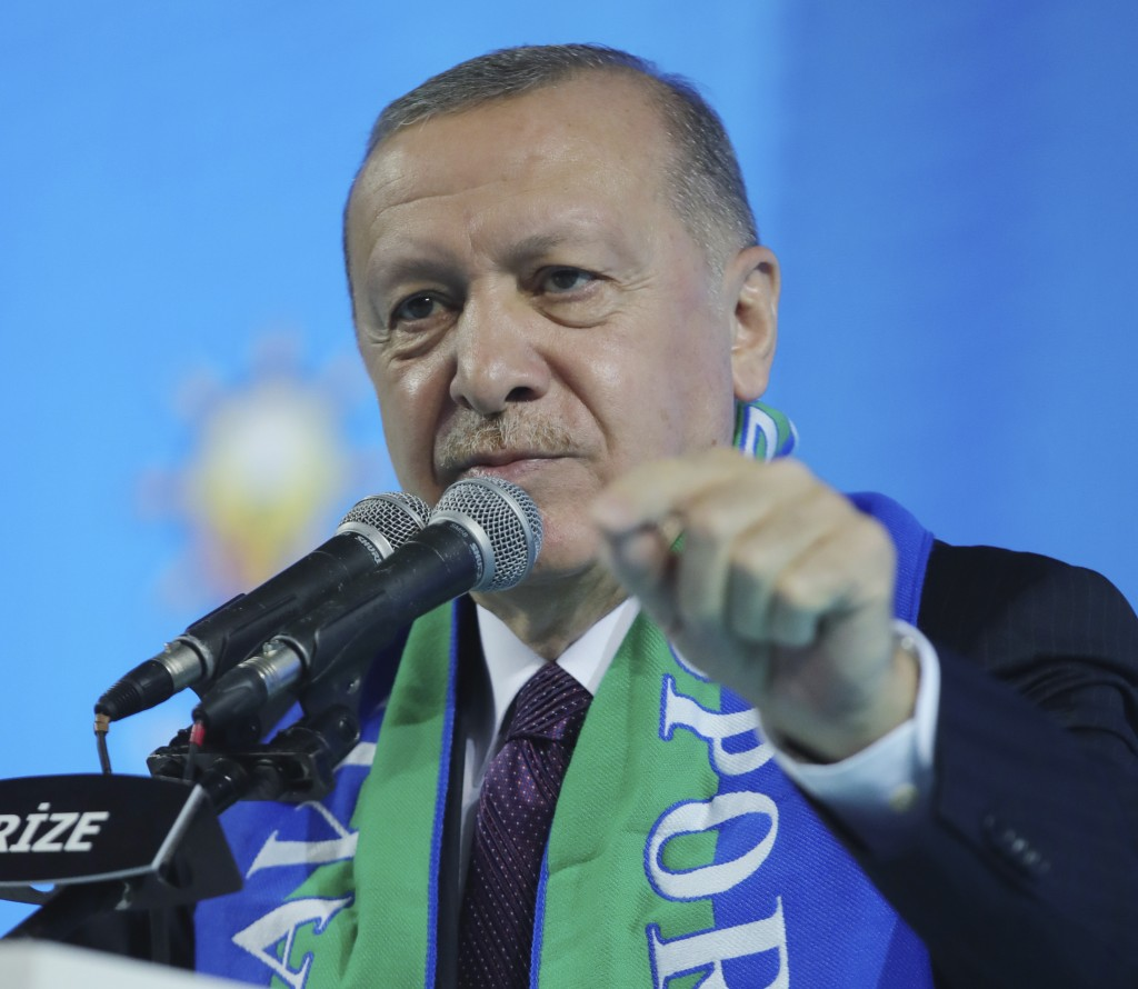 Turkish President Recep Tayyip Erdogan addresses his ruling party's supporters in the Black Sea city of Rize, Turkey, Monday, Feb. 15, 2021. Erdogan l...