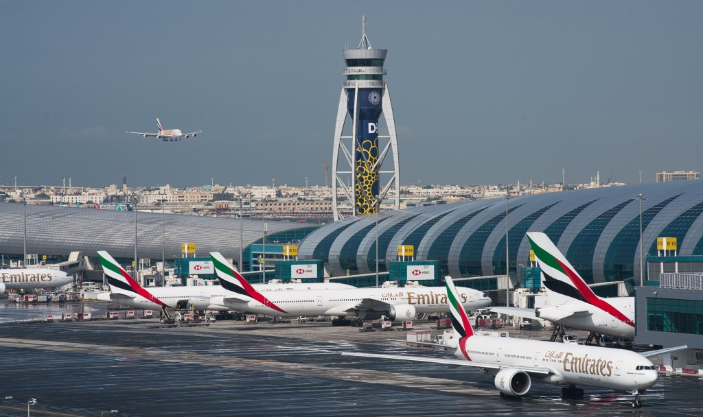 FILE - In this Dec. 11, 2019 file photo, an Emirates jetliner comes in for landing at Dubai International Airport in Dubai, United Arab Emirates. The ...