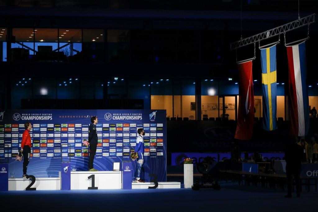Netherlands' Jorrit Bergsma, left and silver medal, New world champion Sweden's Nils van der Poel, center and gold medal, and Russian skater Alexander...