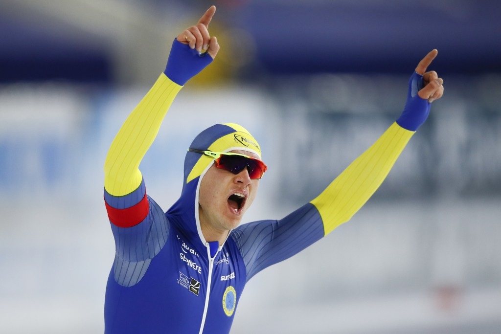 Sweden's Nils van der Poel celebrates setting a new world record on the men's 10,000 meters race of the World Championships Speedskating Single Distan...