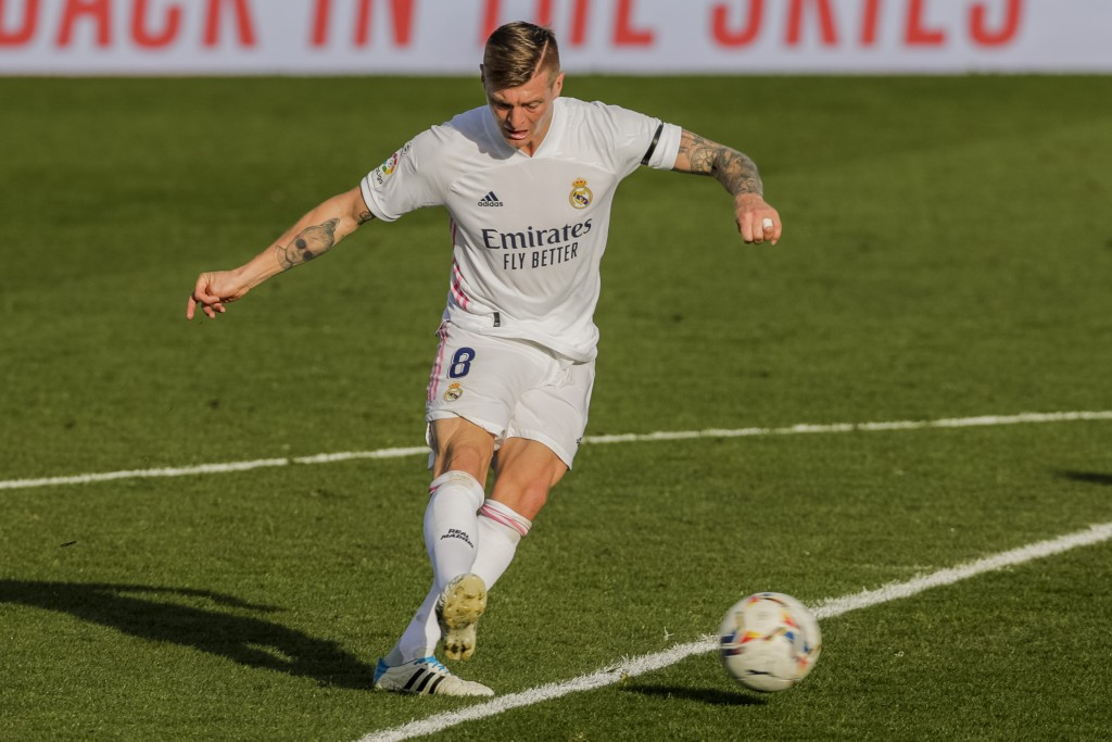 Real Madrid's Toni Kroos shoots to score his team second goal during the Spanish La Liga soccer match between Real Madrid and Valencia at the Alfredo ...