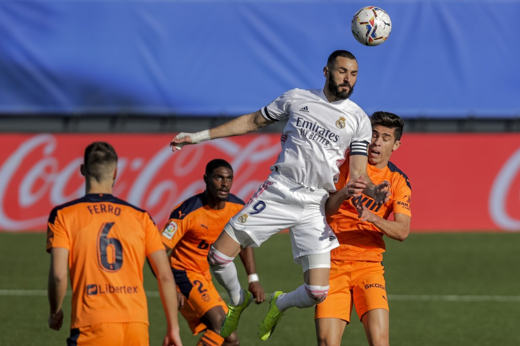 Real Madrid's Karim Benzema heads the ball during the Spanish La Liga soccer match between Real Madrid and Valencia at the Alfredo Di Stefano stadium ...