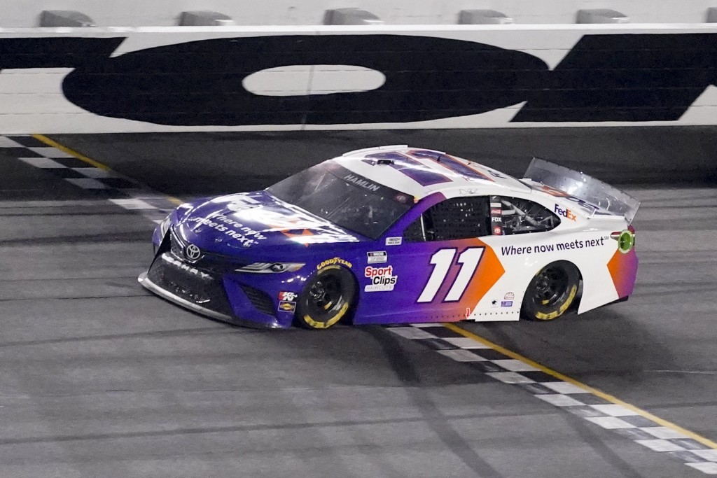 Denny Hamlin wins the first stage during the NASCAR Daytona 500 auto race at Daytona International Speedway, Sunday, Feb. 14, 2021, in Daytona Beach, ...