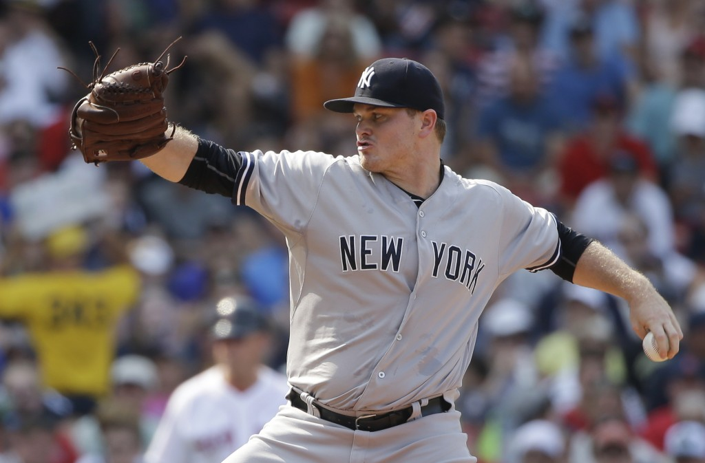FILE - In this July 12, 2015, file photo, New York Yankees relief pitcher Justin Wilson delivers against the Boston Red Sox in the seventh inning of a...