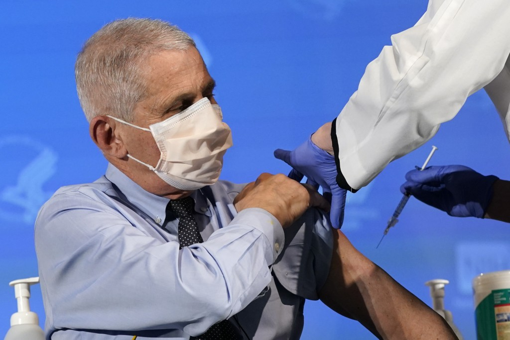 FILE - In this Dec. 22, 2020 file photo, Dr. Anthony Fauci, director of the National Institute of Allergy and Infectious Diseases, prepares to receive...