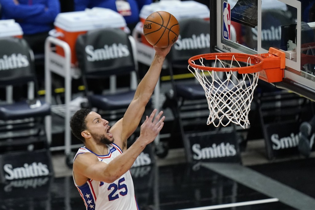 Philadelphia 76ers guard Ben Simmons (25) lays the ball up in the first half during an NBA basketball game against the Utah Jazz Monday, Feb. 15, 2021...