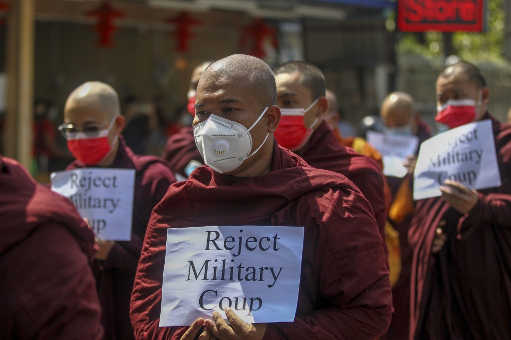Buddhist monks march during a protest against the military coup in Yangon, Myanmar Tuesday, Feb. 16, 2021. Peaceful demonstrations against Myanmar's m...
