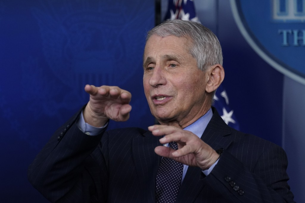 FILE - In this Jan. 21, 2021 file photo, Dr. Anthony Fauci, director of the National Institute of Allergy and Infectious Diseases, speaks with reporte...